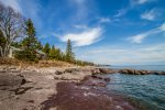 Enjoy the little inlets and unique rock features as you explore the Morning Light shoreline.